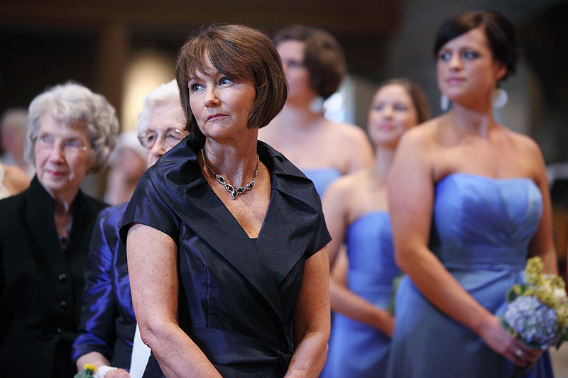 mother of the bride watching daughter come down isle