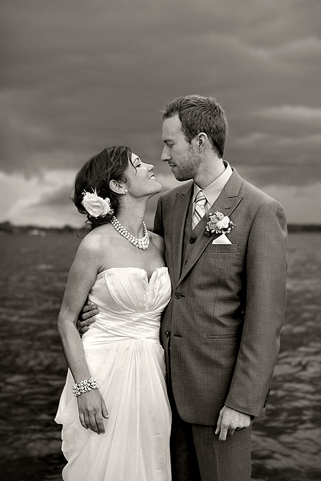 bride and groom on docks - lake minnetonka wedding