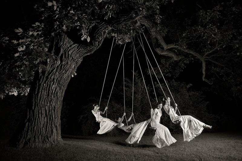 Bride on swing at round barn farm wedding